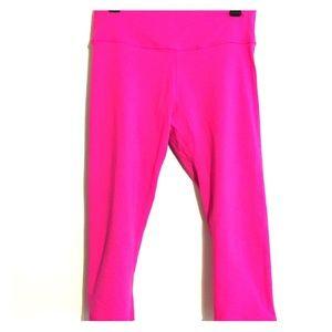 Pink Lululemon workout pants
